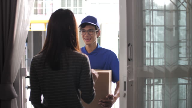 delivery man delivery parcel at home, order from online shopping - united states postal service stock videos & royalty-free footage