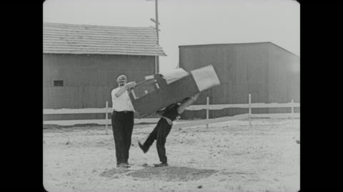 1920 a delivery man drops a piano on man (buster keaton) and makes man sign for the delivery before removing the piano from on top of him - slapstick comedy stock videos & royalty-free footage