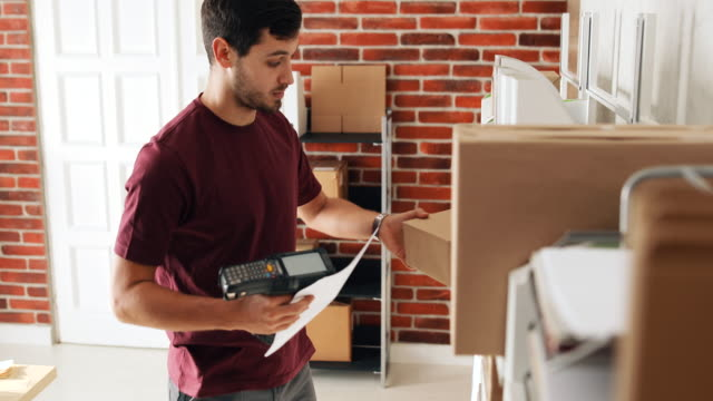 delivery man packing parcel from shopping online delivery to customer, safety package cardboard order at office or warehouse, sme owner entrepreneur concept. - electronic organiser stock videos & royalty-free footage