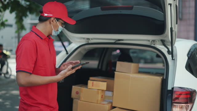 delivery man takes boxes from his van for delivering - epidemic stock videos & royalty-free footage