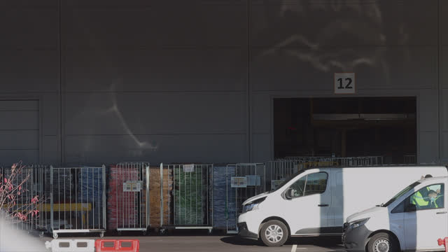 delivery men take boxes from amazon to put them in their utility vehicle. amazon warehouse in the paris region. amazon is an american e-commerce... - gafam stock-videos und b-roll-filmmaterial