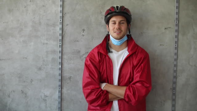 delivery person during coronavirus pandemic - cycling helmet stock videos & royalty-free footage