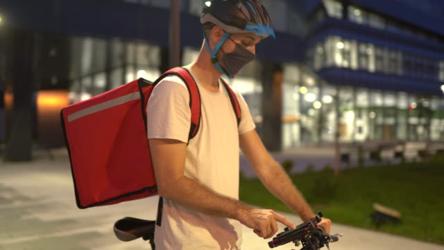 delivery person searching for a location of next customer at night - global positioning system stock videos & royalty-free footage