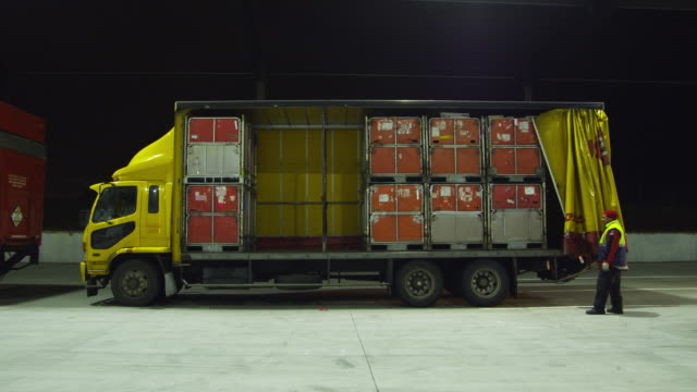 t/l ws delivery truck being unloaded at courier center at night, auckland, new zealand - forklift truck stock videos and b-roll footage