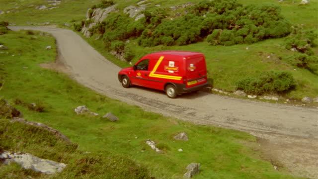 Delivery van driving down lane / Scotland