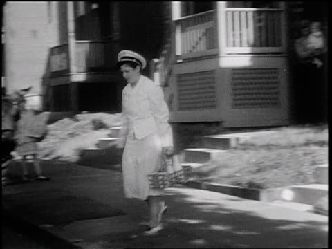 b/w 1931 pan delivery woman walking from house to milk wagon drawn by 2 zebras / st. louis / news. - 1931 stock videos & royalty-free footage