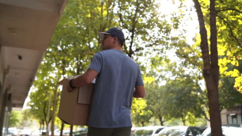 delivery worker carry a packages - giving stock videos & royalty-free footage