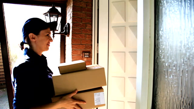 delivery worker delivers packages - receiving stock videos and b-roll footage