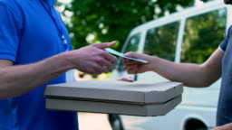 Deliveryman receiving money for pizza transporting, food delivery, part-time job
