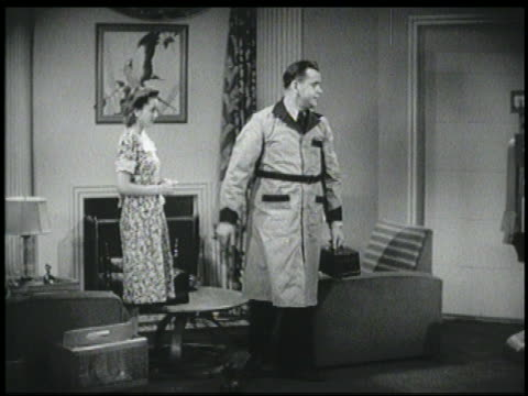 b/w 1940 pan deliveryman says goodbye to woman, robot hands him his hat in living room - prelinger archive stock-videos und b-roll-filmmaterial