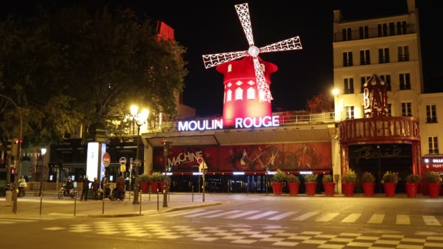 deliverymen chat in front of the moulin rouge and a deserted place blanche at curfew time on october 18, 2020 in paris, france. france. the french... - politics illustration stock videos & royalty-free footage