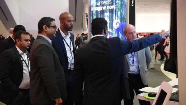 a deloitte representative speaks to attendees at the oracle openworld 2017 conference and pass large signage in san francisco california us on monday... - oracle corporation stock-videos und b-roll-filmmaterial