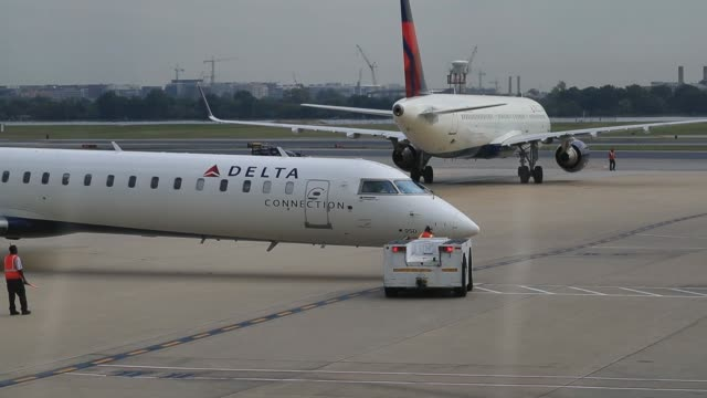 Delta Air Lines Inc aircraft are pushed out from the gates before departure at Ronald Reagan National Airport in Washington DC US on Friday Sept 22...