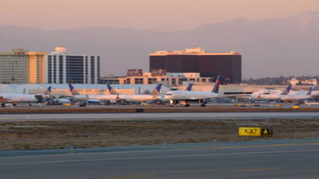 Delta Boeing-757 takes off from LAX, golden sunset light
