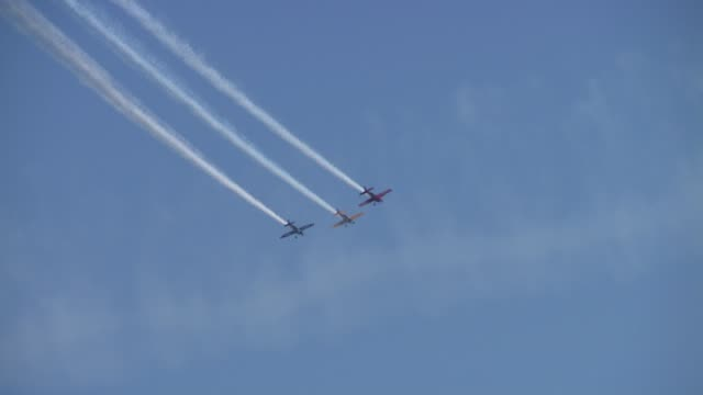 delta team, flying extra 300 aircrafts, create formation in the air. the 2013 chicago air and water show attracted 1.7 million spectators. delta team... - chicago air and water show stock videos & royalty-free footage
