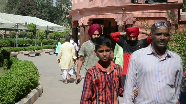 Demands for apology continue 100 years after Amritsar massacre INDIA Punjab Amritsar Jallianwala Memorial EXT People gathering around outside...