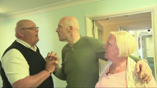 early onset dementia in the uk england int gareth wilmot with arm around lesley wilmot and giving graham wilmot a high five and kiss gareth wilmot... - richard pallot stock-videos und b-roll-filmmaterial