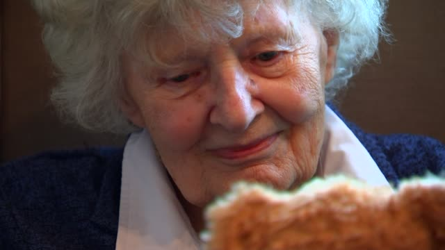dementia film project; england: int 90-year-old beryl ravenscroft sitting in chair looking at teddy bear penny croucher interview sot - in mother's... - dementia stock videos & royalty-free footage