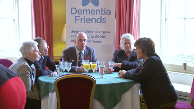 dementia friends charity event at held at downing st shows interior shots lynda bellingham talking at table to guests in downing st dementia friends... - lynda bellingham stock videos & royalty-free footage