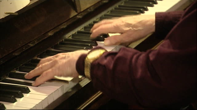 g8 dementia summit sets targets for treatment and cure location various shots dominic batty playing piano jill batty interview sot jill and dominic... - annual event stock videos and b-roll footage