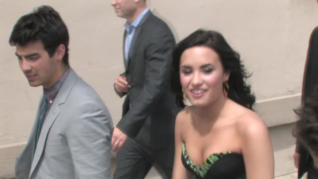 demi lovato & jonas brothers leaving el capitan theatre in hollywood at the celebrity sightings in los angeles at los angeles ca. - el capitan theatre stock videos & royalty-free footage