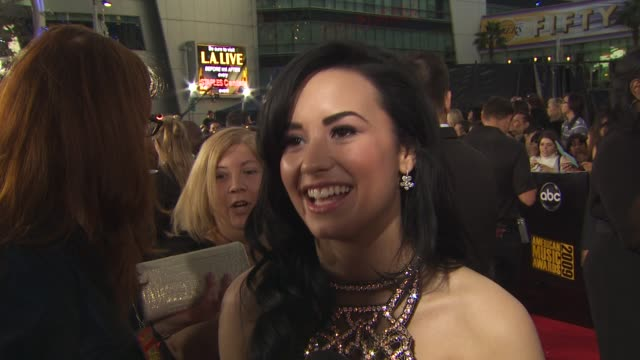 Demi Lovato on what she's wearing on walking the carpet at the American Music Awards on who she's looking forward to seeing perform and on what she's...
