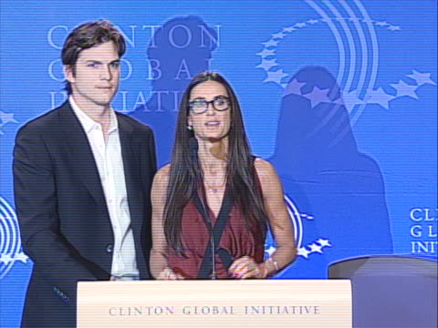 demi moore and ashton kutcher speaking at podium together - against child sex trafficking at the clinton global initiative conference. in this clip,... - ashton kutcher stock videos & royalty-free footage