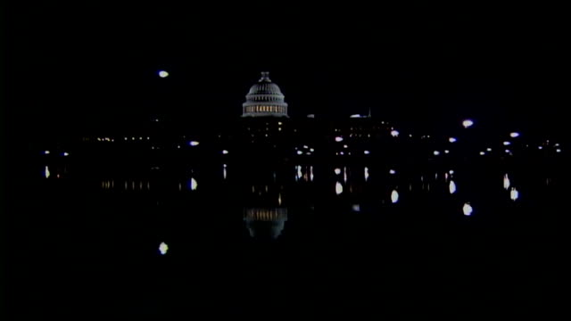 democrat nancy pelosi takes place as first female speaker at the house of representatives night general view of congress building with river in... - nancy pelosi stock videos and b-roll footage