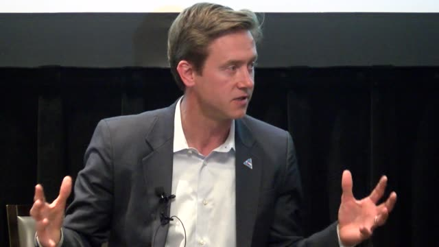 Democratic candidate for governor Mike Johnston talks about what he would do in terms of gun control if elected during a fundraiser at the Denver...