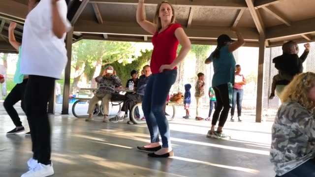 democratic congressional candidate katie hill dances with supporters at a halloween carnival campaign event on october 21, 2018 in lancaster,... - hill点の映像素材/bロール