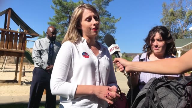 democratic congressional candidate katie hill speaks to a reporter after casting her ballot on election day on november 6, 2018 in agua dulce,... - hill点の映像素材/bロール