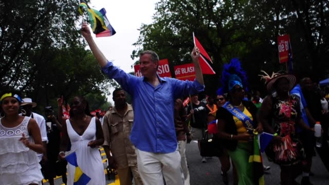 Democratic mayoral candidate Bill de Blasio campaigning during mayoral election in the Labor Day Parade Eastern Parkway Crown Heights Brooklyn New...