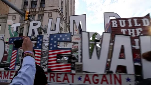 democratic party 2020 presidential debate takes place in detroit usa michigan detroit ext float with sign 'trump' along street supporters of donald... - debate stock videos and b-roll footage