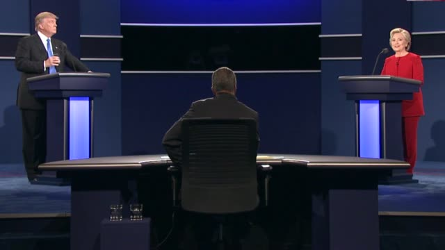 democratic party presidential candidate hillary clinton and republican party presidential candidate donald trump continue to discuss trade and jobs... - debatte stock-videos und b-roll-filmmaterial