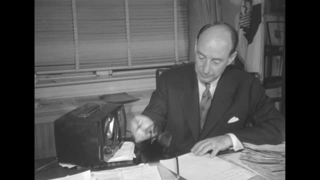 cu democratic presidential candidate adlai stevenson at desk in governor's mansion stack of papers and radio on desk / ls stevenson and running mate... - governmental occupation stock videos & royalty-free footage