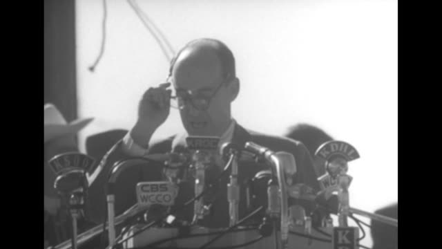 vs democratic presidential candidate adlai stevenson steps to stage stands behind microphones acknowledges applause then starts introductory remarks... - candidate stock videos and b-roll footage