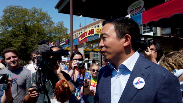 democratic presidential candidate andrew yang tries some food including a roasted turkey leg and lemonade during the iowa state fair august 09 2019... - agricultural fair stock videos & royalty-free footage