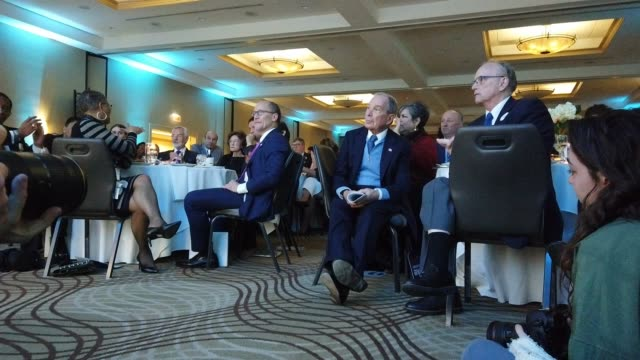 democratic presidential candidate former new york city mayor mike bloomberg sits at a table next to tom perez democratic national committee chairman... - candidate stock videos & royalty-free footage