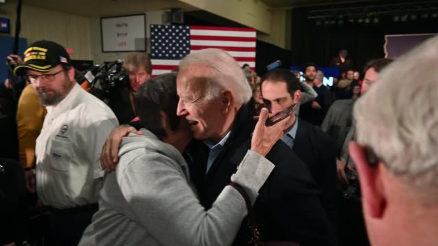 democratic presidential candidate former vice president joe biden greets supporters during a campaign stop on february 1 2020 in waterloo iowa - 民主主義点の映像素材/bロール