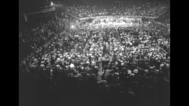 democratic presidential candidate gov adlai stevenson standing at podium in madison square garden pausing in his speech as audience applauds /... - adlai stevenson ii stock videos and b-roll footage