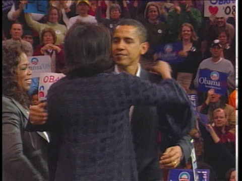 democratic presidential candidate senator barack obama hugs talk show host oprah winfrey and his wife michele. - (war or terrorism or election or government or illness or news event or speech or politics or politician or conflict or military or extreme weather or business or economy) and not usa stock videos & royalty-free footage