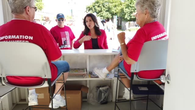 democratic presidential candidate us rep tulsi gabbad greets two ladies at an information booth after she delivered campaign speech at the des moines... - politician stock videos & royalty-free footage