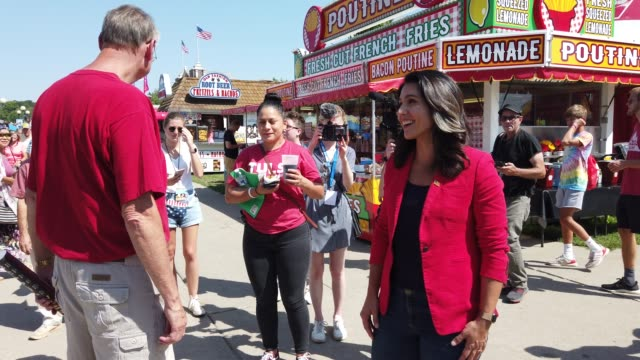 democratic presidential candidate us rep tulsi gabbad greets voters after she delivered campaign speech at the des moines register political soapbox... - agricultural fair stock videos & royalty-free footage