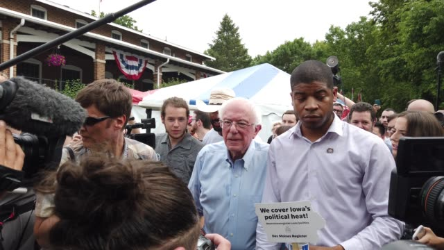 democratic presidential candidate us sen bernie sanders is followed by members of the media after he delivered campaign speech at the des moines... - presidential candidate stock videos & royalty-free footage