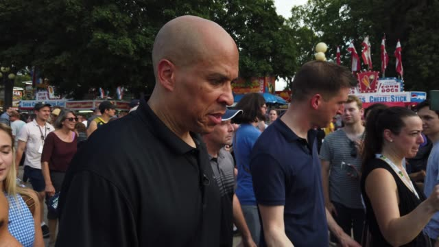 democratic presidential candidate us sen cory booker talks to members of the media as he tours the fairground after he delivered campaign speech at... - around the fair n.y stock videos & royalty-free footage