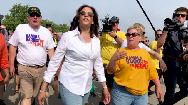 democratic presidential candidate u.s. sen. kamala harris walks with former iowa democratic party chair sue dvorsky while attending the iowa state... - presidential candidate stock videos & royalty-free footage