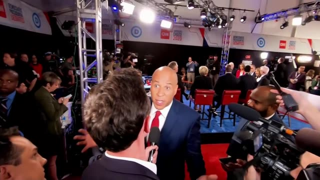 democratic presidential candidates target joe biden in latest television debate usa michigan detroit int cory booker interview sot - presidential candidate stock videos & royalty-free footage