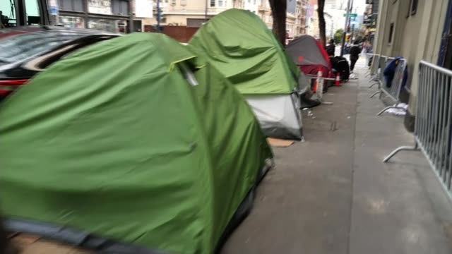 democratic presidential nomination: super tuesday preview; california and vermont, usa; various shots of homeless people along and in sleeping bags... - homelessness stock videos & royalty-free footage