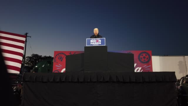 democratic presidential nominee joe biden addresses a drivein campaign rally at the michigan state fairgrounds october 16 2020 in novi michigan with... - political rally stock videos & royalty-free footage