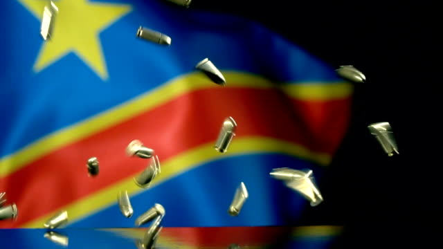 democratic republic of the congo flag behind bullets falling in slow motion - weaponry stock videos & royalty-free footage